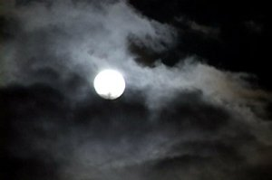 stock-footage-time-lapse-of-glowing-full-moon-at-night-as-clouds-move-pass-rapidly